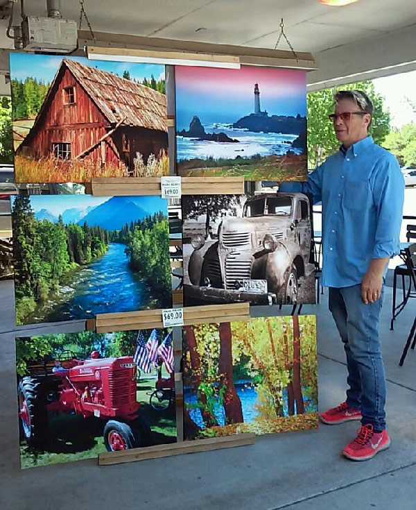mark_Standing_in_front_of_prints